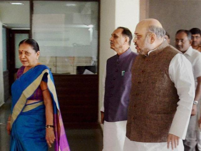 BJP president Amit Shah, Gujarat CM Anandiben Patel and state BJP chief Vijay Rupani in Gandhinagar.