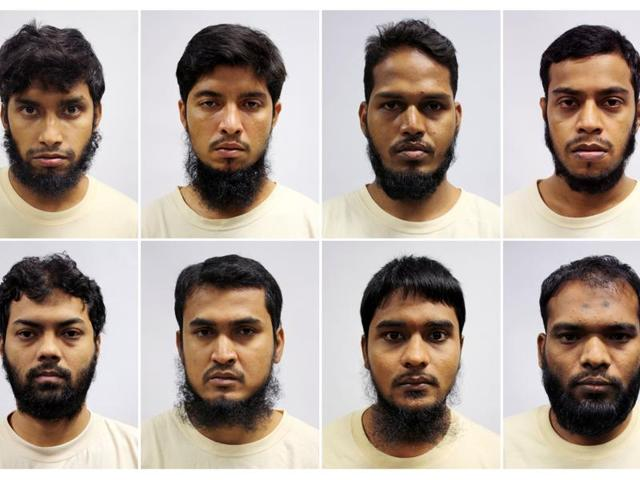 A combination of mugshots of Bangladeshi construction and marine industry workers - Islam Shariful (top left to right), Mamun Leakot Ali, Md Jabath Kysar Haje Norul Islam Sowdagar, Miah Rubel, Rahman Mizanur (bottom left to right), Sohag Ibrahim, Sohel Hawlader Ismail Hawlader and Zaman Daulat - who were part of the Islamic State in Bangladesh and detained in Singapore in April are seen in this handout photo released on Tuesday.