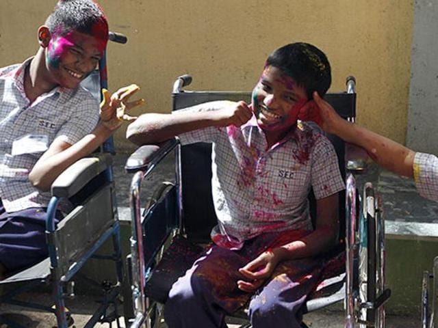Disabled children celebrated Holi in Mumbai. The government says it scheme for physically challenged people is failing.