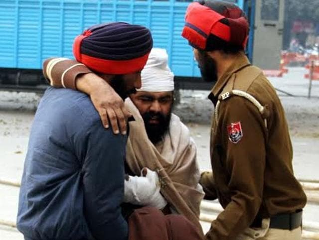 Cops lift car bomb blast accused Jagmohan Singh up to the court during a hearing in Jalandhar.