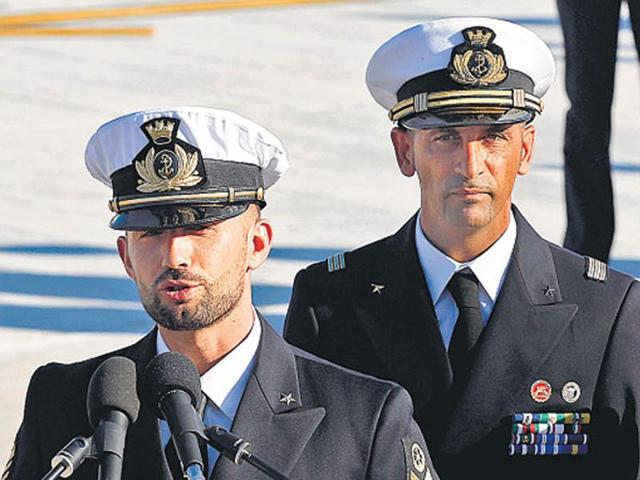 File photo of  Italian marines Massimiliano Latorre (R) and Salvatore Girone (L), accused of killing two Indian fishermen, arriving at Ciampino airport near Rome