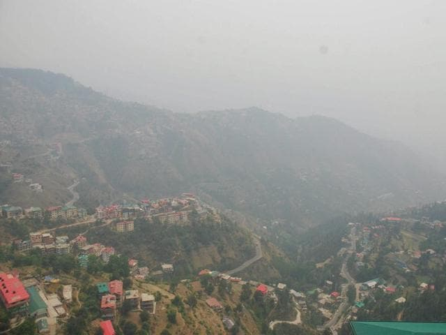 A blanket of smog extends over Shimla town as forest fire continues in Himachal Pradesh and Uttarakhand states, on Tuesday.