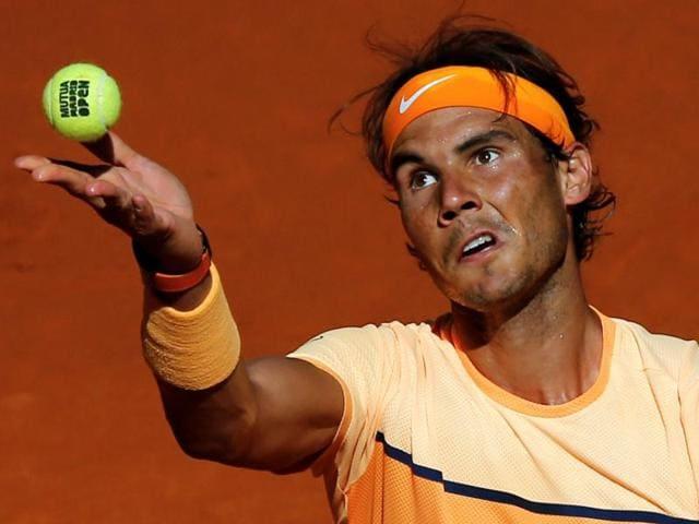 Rafael Nadal serves to Andrey Kuznetsov.