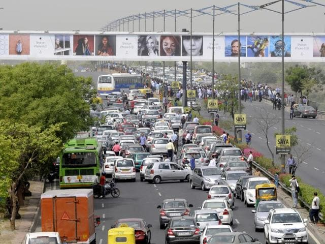 Cab drivers protest at the DND Yamuna bridge against the diesel cab ban on Tuesday.