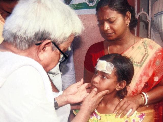 Left Front chairman Biman Bose at the Haridevpur residence of the eight-year-old child who was beaten up by goons allegedly backed by the ruling party on April 30.