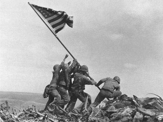 The iconic photo of American servicemen raising their national flag on top of Iwo Jima's Mount Suribachi in 1945.