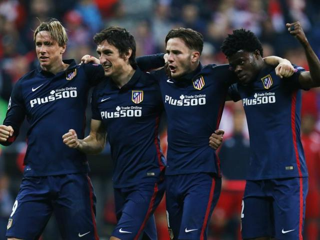 Atletico Madrid's Fernando Torres, Stefan Savic, Saul Niguez and Teye Thomas celebrate after confirming their spot in the Champions League final.