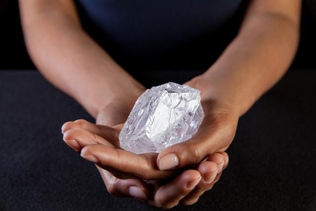 A Sotherby's employee holds the Lesedi La Rona Diamond in New York City. The diamond the size of a tennis ball that is the largest discovered in more than a century could sell at auction for more than $70 million.