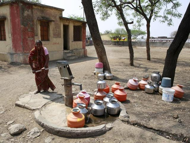 (Representative image)A woman uses a hand-pump to collect water at a Primary Health Centre in Latur.