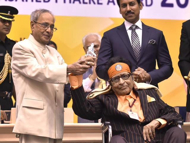 President Pranab Mukherjee shows a silver statue of Sai Baba gifted to him by veteran actor Manoj Kumar. The veteran actor was honoured with Dadasaheb Phalke Award at the 63rd National Film Awards 2015 function in New Delhi on Tuesday.