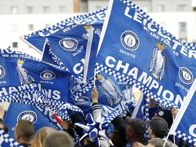 Leicester City fans celebrate with flags after they won their maiden English Premier League title, on Tuesday.