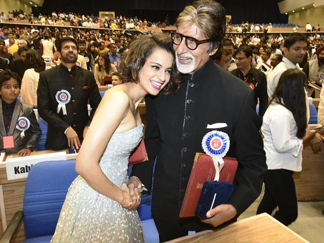 The winners' table: Actors Amitabh Bachchan and Kangana Ranaut, who received best actor and best actress award respectively during the 63rd National Film Awards ceremony, hug at Vigyan Bhawan in New Delhi on Tuesday.