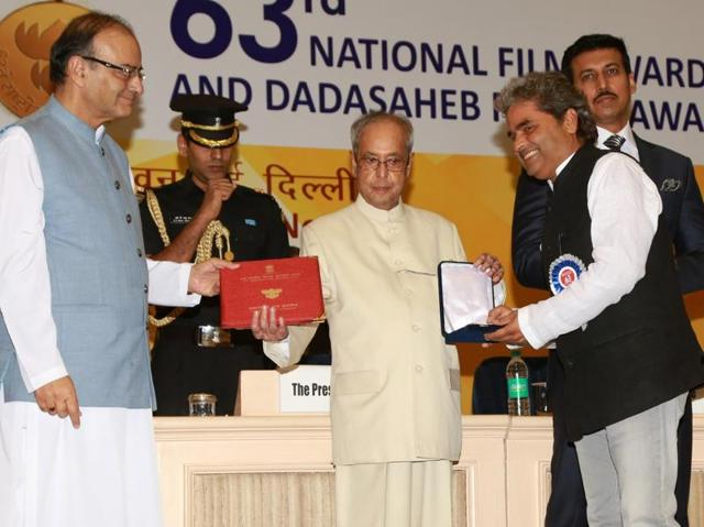 Filmmaker Vishal Bhardwaj receives the Best Screenplay Writer (adapted) Award for Talvar from President Pranab Mukherjee during the 63rd National Film Awards ceremony at Vigyan Bhawan in New Delhi.