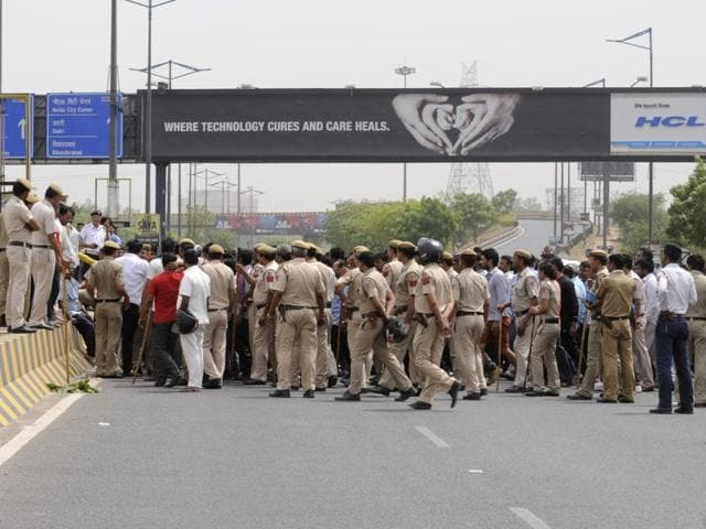 Cab drivers protest at DND Yamuna bridge on Tuesday.