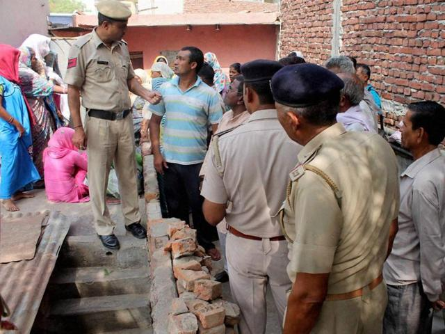 Police investigate the house where a woman killed her three daughters and committed suicide in Faridabad on Wednesday.