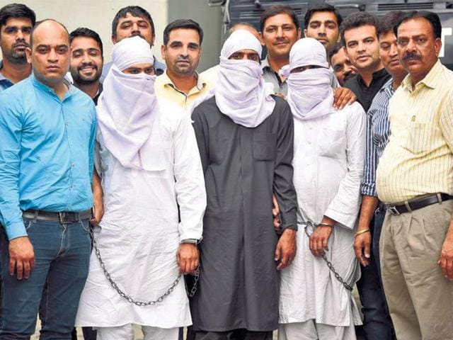Three suspected Jaish militants, arrested from the Capital and UP in late-night raids, in New Delhi on Wednesday.