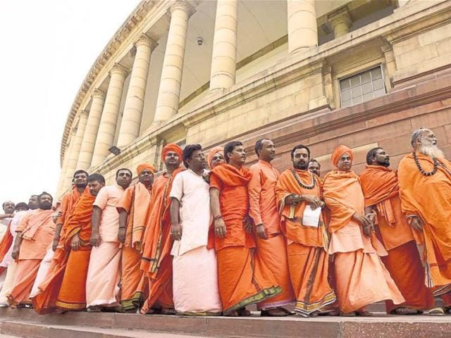 Sadhus wait in line to enter the Visitor's Gallery at Parliament House on Thursday.