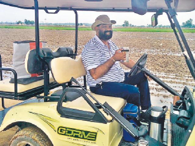 Amarjit Singh Dullet driving his electric golf cart.
