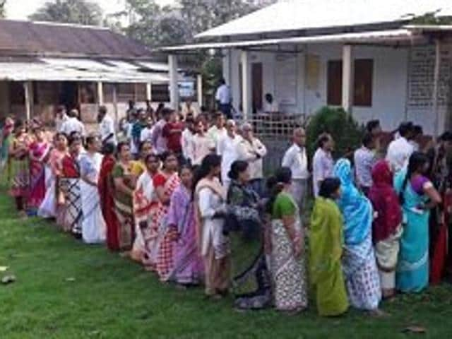 People gather outside a polling booth in Cooch Behar to cast their votes in the final phase of West Bengal assembly elections.