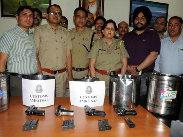 Four 9 mm pistols and seven empty cartridges were recovered by customs officials.