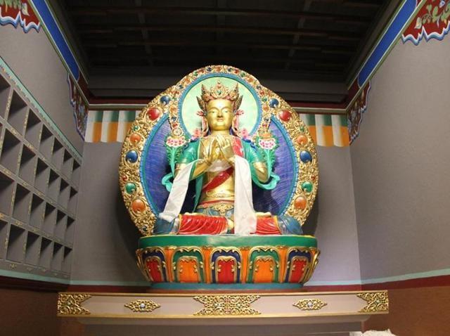 A six-foot-tall sculpture of Maitreya, the future Buddha