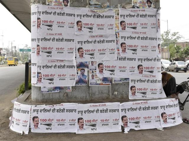 Aam Aadmi Party posters claiming that it will win 100 seats in the upcoming assembly elections pasted under a flyover near the bus stand in Amritsar on Wednesday.