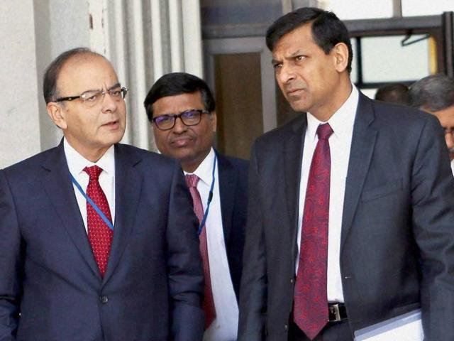 Union finance minister Arun Jaitley with RBI Governor Raghuram Rajan. India's $121 billion troubled debt pile, over $100 billion of which is on the books of state-owned banks, has come under close scrutiny from prosecutors, the media and politicians.