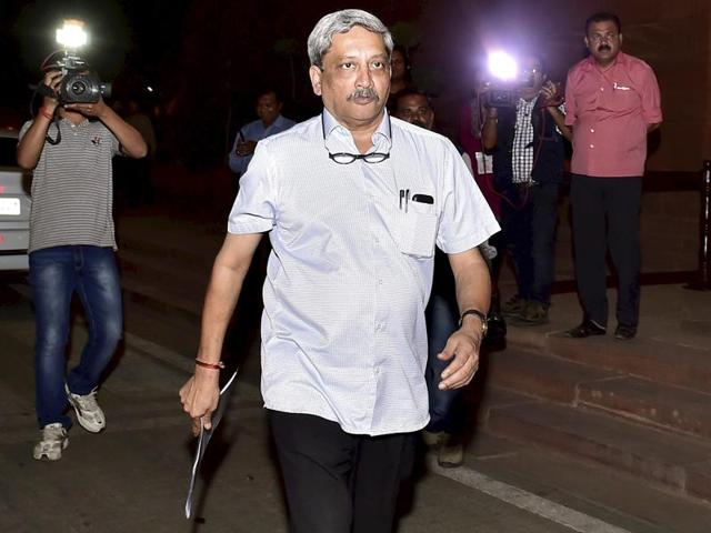 Defence minister Manohar Parrikar arrives to attend a cabinet meeting at Parliament Library in New Delhi on Wednesday.