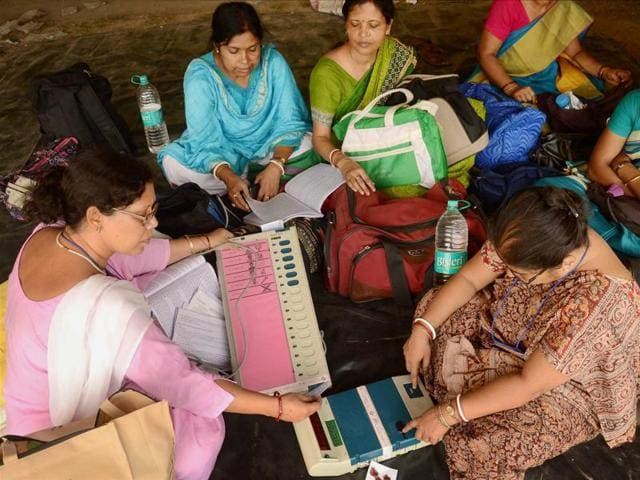 Polling officials collect EVMs at a distribution centre in East Midnapore on Wednesday.
