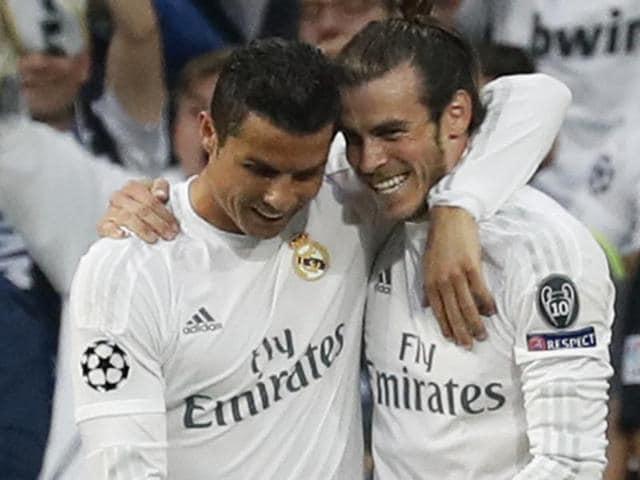 Real Madrid's Gareth Bale celebrates scoring their first goal with Cristiano Ronaldo.