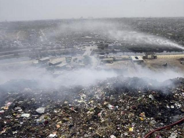 The Bhalswa dumpyard caught fire in April due to soaring temperatures. Bhalswa is one of the four major landfills in Delhi.(HT File Photo)