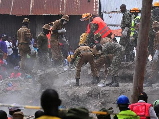 Rescue workers remove debris from the rubble of the six-storey building that collapsed killing 23 people in Nairobi's suburb of Huruma, on May 3, 2016.