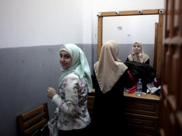 Palestinian actresses prepare themselves in a room to perform a Gaza version of Shakespeare's