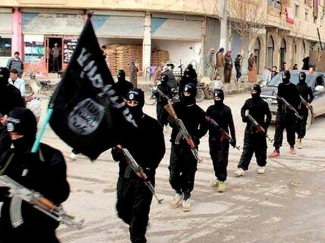 The Islamic State has halved its fighters' monthly salaries, which the US Congressional Research Service has previously estimated at anywhere between $400 and $600.(AP File Photo)
