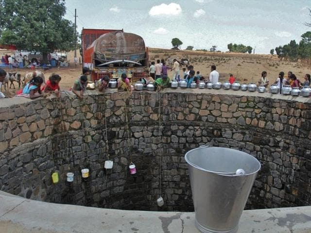 Villagers fetch water from a well filled by a tanker in Thakrechi Wadi village at Shahapur Taluka in Thane district.