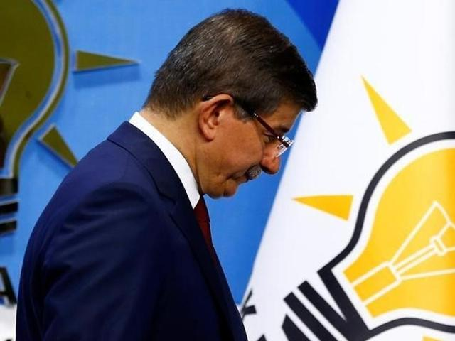 Turkish Prime Minister Ahmet Davutoglu leaves a news conference at his ruling AK Party headquarters in Ankara, Turkey.