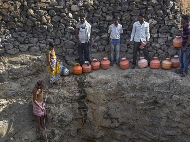 Men risk their lives to fetch water by going down into a 40-feet well in Latur on Saturday.