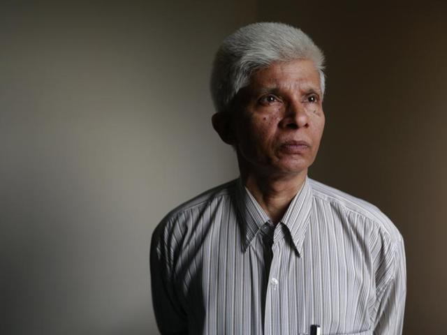 Dhaka University professor Azizur Rahman works on his computer at his home in Dhaka, Bangladesh. He is among a growing number of political moderates and intellectuals seeking protection in Bangladesh, where at least 15 writers, activists, religious minorities and foreign aid workers have been killed in targeted attacks since the start of 2015.