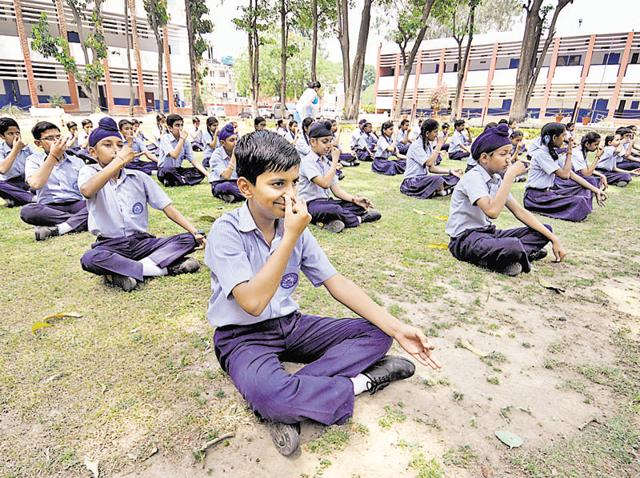 Students of Government Model School, Sector 16, Chandigarh, during a yoga camp on the school campus on Wednesday.