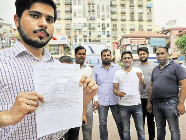 Shop owners said the March tariff was shown as Rs 11.32 per unit when the standard charges do not exceed Rs 8.50.