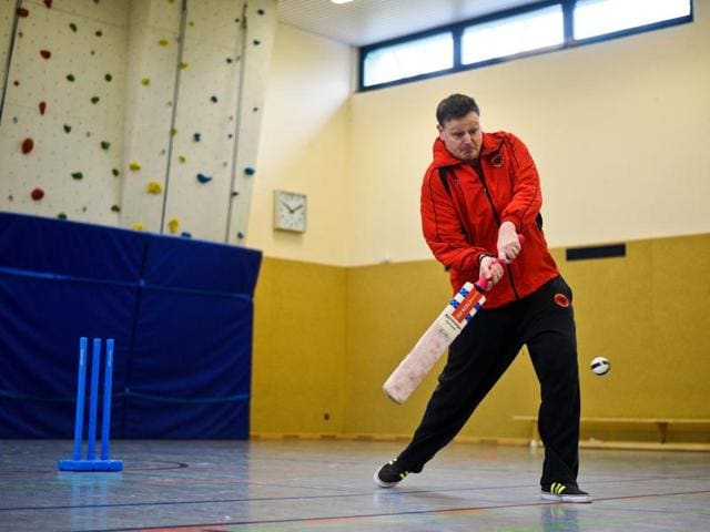 Brian Mantle, president of the Deutscher Cricket Bund (DCB) and member of Altendorf 09 Blue Tigers cricket team leads a training for Afghan refugees in Essen, western Germany.