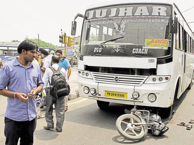 The bus that hit the motorcycle; (below) one of the injured bikers being taken to hospital in Ludhiana on Thursday. JS Grewal/HT