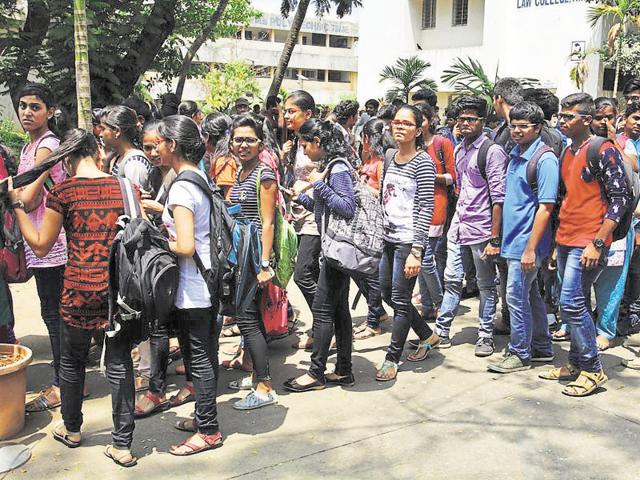 Students appearing for the MH-CET await outside a college in Thane on Thursday.