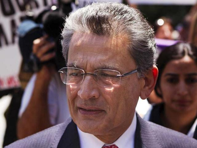 Former Goldman Sachs Group director Rajat Gupta leaving Manhattan Federal Court following a guilty verdict in his trial in New York on June 15, 2012.