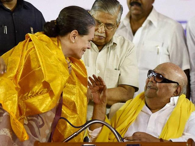 DMK chief M Karunanidhi interacts with Congress president Sonia Gandhi during an election rally in Chennai.