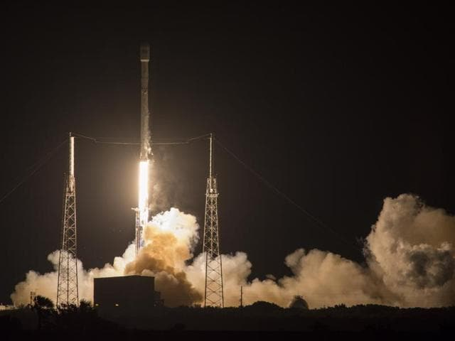 SpaceX's Falcon 9 rocket lights up the sky during a launch from Cape Canaveral Air Force Station in Florida early on Friday. For the second month in a row, the company landed a rocket on an ocean platform, this time following the launch of a Japanese communications satellite.