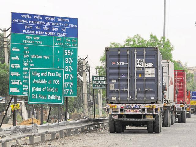 Trucks can be seen parked on the stretch leading to Manesar.