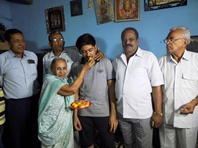 Abineet Parichha, who topped ICSE's class 10 exam at all-India level with his family members at home in Balangir.