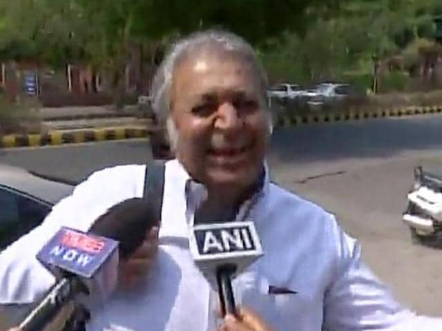 SP Tyagi's cousin Sanjeev 'Julie' Tyagi interacts with journalists outside CBI headquarters in Delhi