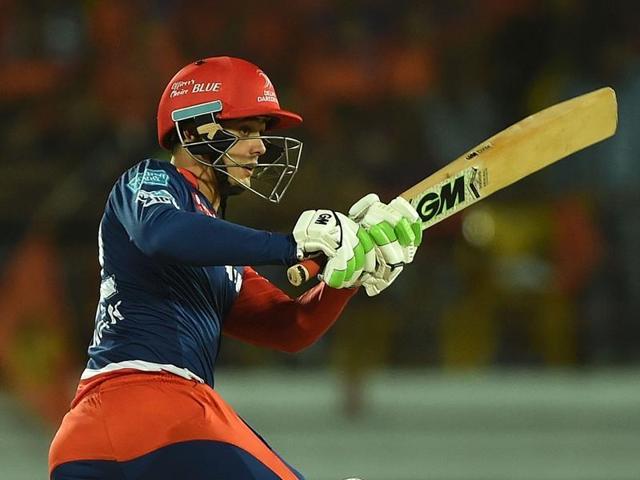 Delhi Daredevils batsman Quinton de Kock plays a shot during the IPL match against Gujarat Lions at The Saurashtra Cricket Association Stadium in Rajkot on May 3, 2016.